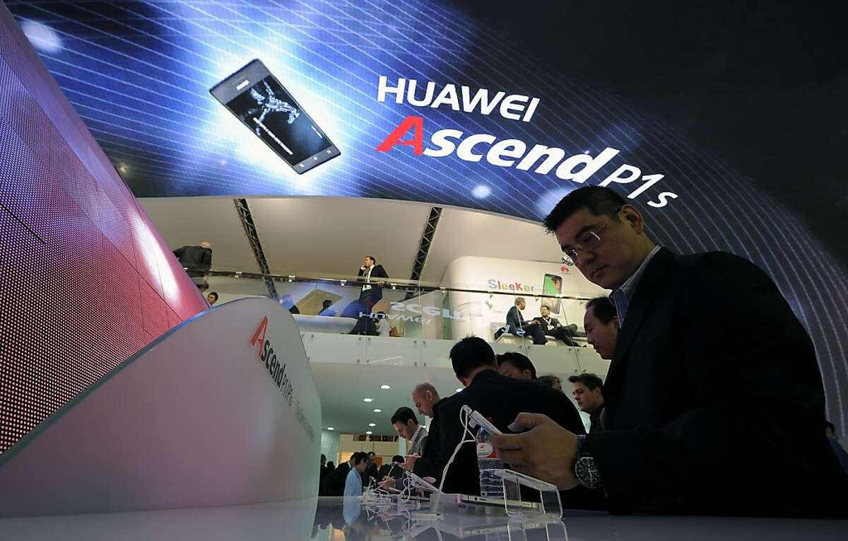 A man checks the Huawei Ascend P1S smartphone during the Mobile World Congress on February 28, 2012 in Barcelona. The 2012 Mobile World Congress, the world's biggest mobile fair, will be held from February 27 to March 1 in Barcelona. AFP PHOTO/LLUIS GENE (Photo credit should read LLUIS GENE/AFP/Getty Images)