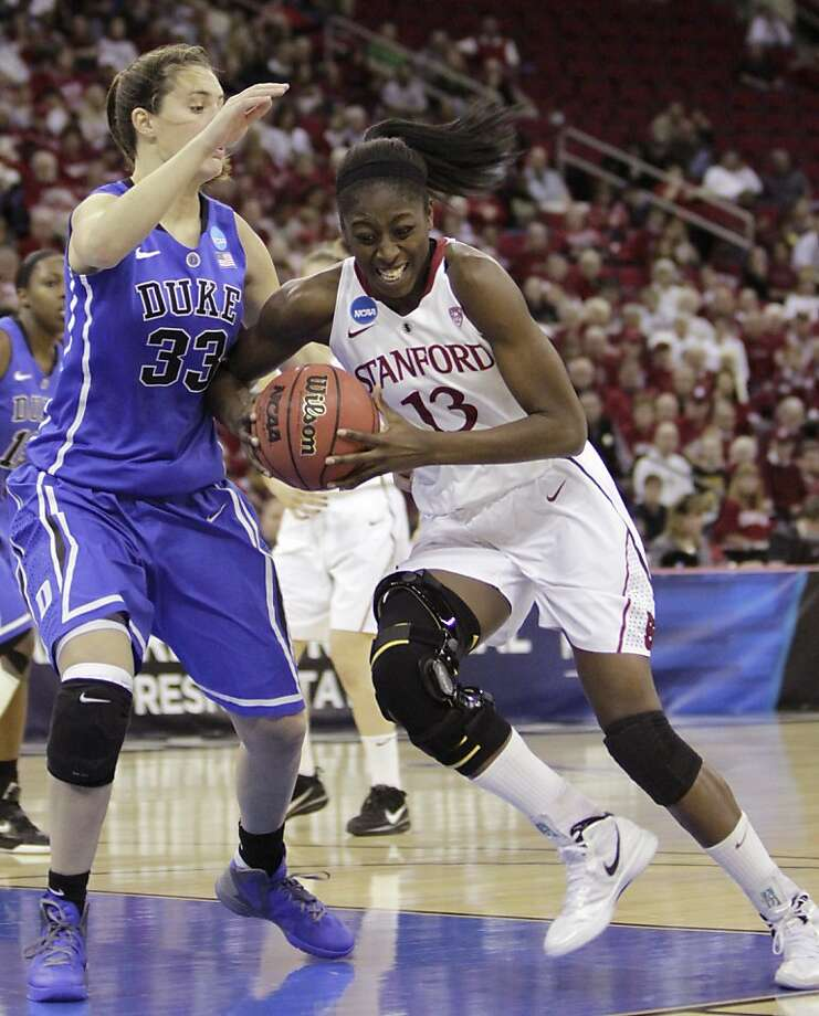 Stanford's Chiney Ogwumike,  right, drives to the basket against Duke's Haley Peters during the first half of an NCAA women's tournament regional final college basketball game,  Monday, March 26, 2012, in Fresno, Calif.(AP Photo/Rich Pedroncelli) Photo: Rich Pedroncelli, Associated Press