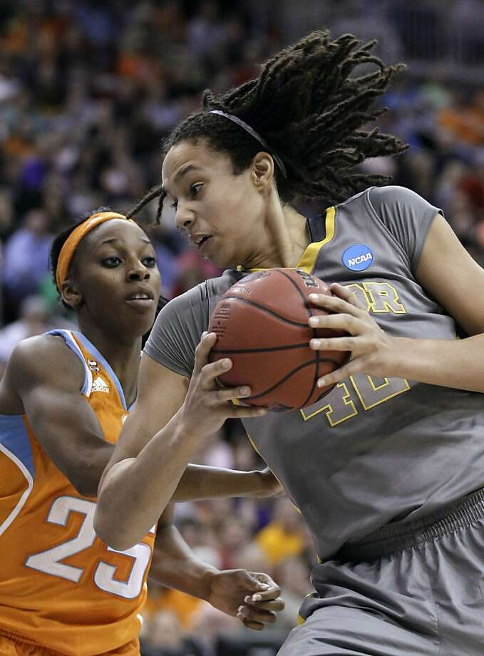 Baylor center Brittney Griner drives around Tennessee's Glory Johnson, left, during the second half of an NCAA women's college basketball tournament regional final, Monday, March 26, 2012, in Des Moines, Iowa. Baylor won 77-58. (AP Photo/Charlie Neibergall) Photo: Charlie Neibergall, Associated Press