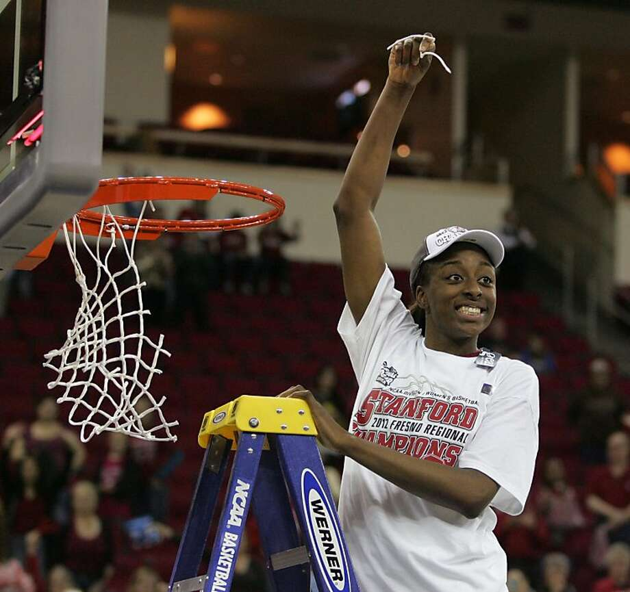 Stanford's Nnemkadi Ogwumike celebrates by cutting a piece of the net after defeating Duke in the second half of an NCAA women's tournament regional final college basketball game Monday, March 26, 2012, in Fresno, Calif. Stanford won 81-69. (AP Photo/Gary Kazanjian) Photo: Gary Kazanjian, Associated Press