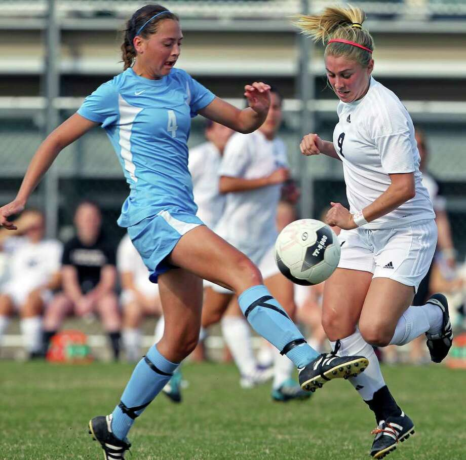 Johnson midfielder Caitlin Schwartz — seen here fighting Churchill's Lauren Peck for a loose ball on March 13 — had two game-winning goals as the Jaguars defeated Reagan and Lee to move into second place in District 26-5A, their best finish in league play. Photo: TOM REEL, San Antonio Express-News / San Antonio Express-News