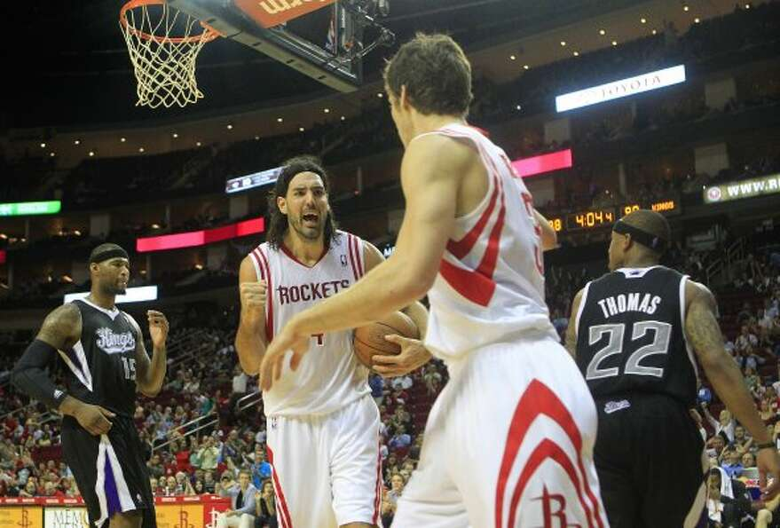 Rockets power forward Luis Scola, center, reacts after teammate Goran Dragic scores in the fourth qu