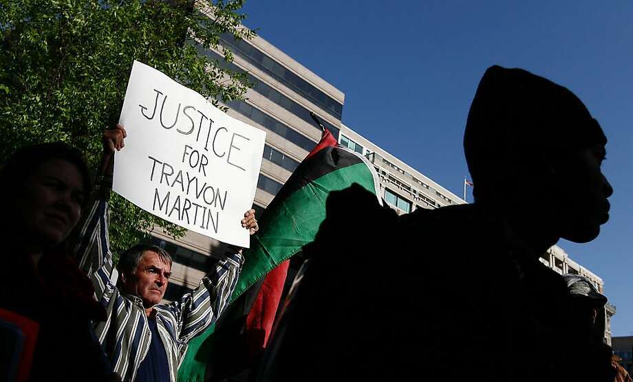 WASHINGTON, DC - MARCH 26:  Members of the National Black United Front hold a Trayvon Martin Solidarity Rally outside the U.S. Department of Justice March 26, 2012 in Washington, DC. Trayvon Martin, a 17-year-old Florida high school student, was shot and killed, in Sanford, Florida on February 26. (Photo by Win McNamee/Getty Images) Photo: Win McNamee, Getty Images