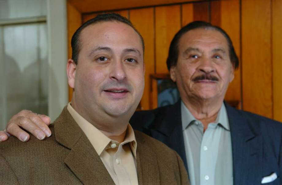 Anderson Ayala, left, and his dad Manuel, have both won seats on the Bridgeport City Council, Anderson in the 131st District and Manuel in the 137th. Here, they pose at Manuel's home in Bridgeport, Conn. on Wednesday Nov. 11, 2009. They are believed to be the only father-son team to serve simultaneously on the City Council in Bridgeport's history, and possibly the state. Photo: Christian Abraham / Connecticut Post