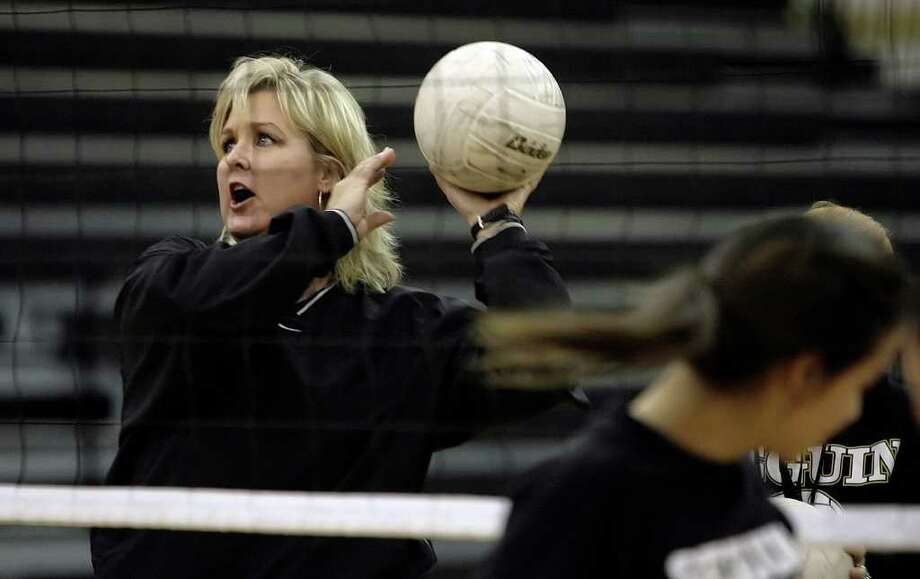 Seguin's Robin Gerlich, the Greater San Antonio area's 10th-winningest volleyball coach, was hired Monday as volleyball coach and assistant athletic director at New Braunfels. Photo: KIN MAN HUI, San Antonio Express-News / kmhui@express-news.net