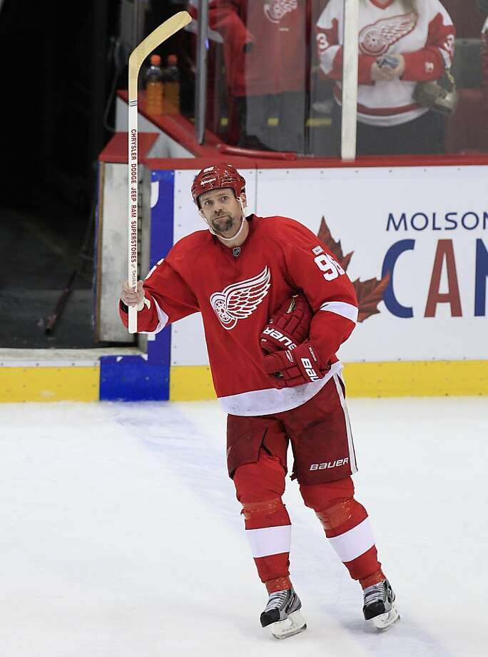 Detroit Red Wings left wing Tomas Holmstrom (96) of Sweden acknowledges the crowd after an NHL hockey game against the Columbus Blue Jackets in Detroit, Monday, March 26, 2012. (AP Photo/Carlos Osorio) Photo: Carlos Osorio, Associated Press
