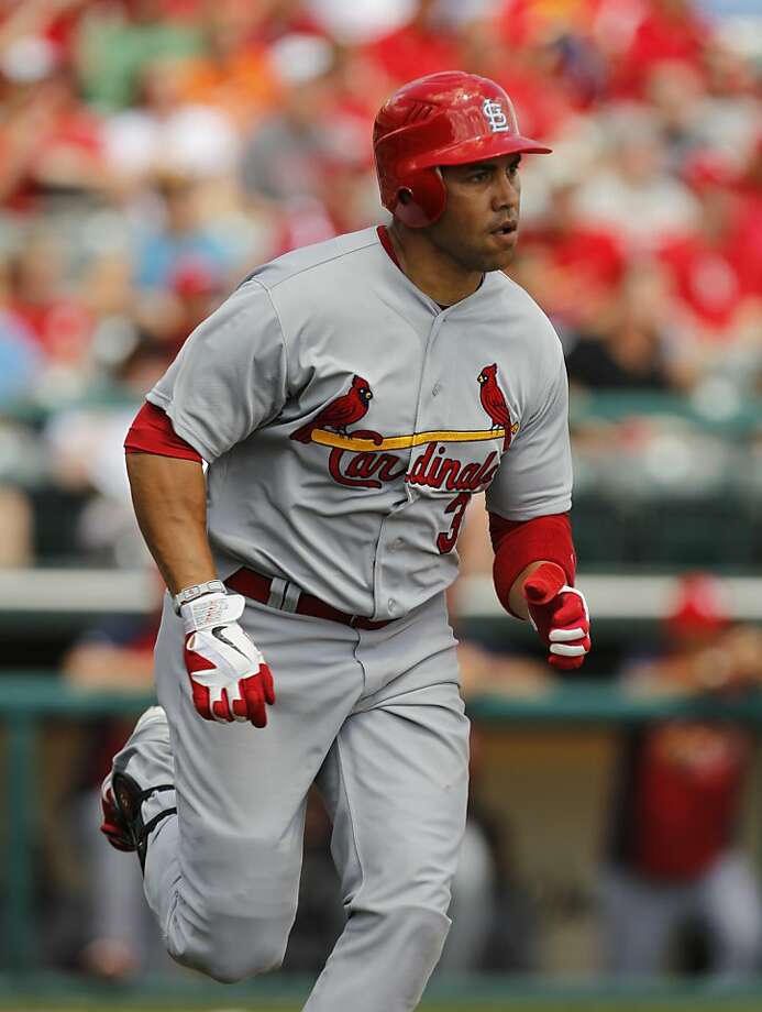 St. Louis Cardinals' Carlos Beltran hits a solo home run against the Atlanta Braves in the sixth inning of a spring training baseball game in Kissimmee, Fla., Monday, March 19, 2012. (AP Photo/Paul Sancya) Photo: Paul Sancya, Associated Press