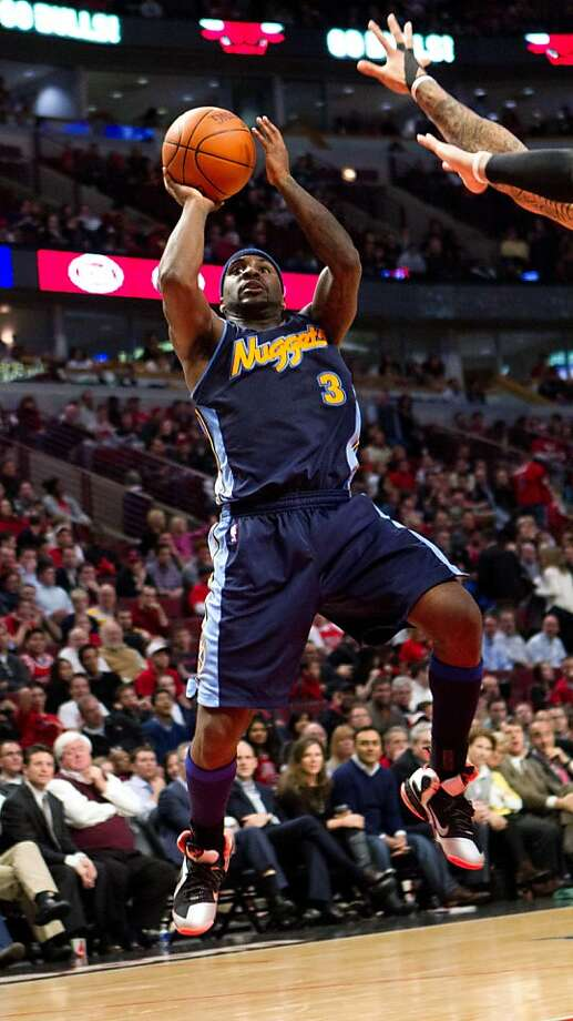Denver Nuggets' Ty Lawson put up a basket in the fourth quarter as the Nuggets beat the Chicago Bulls 108-9 in an NBA basketball game on Monday, March 26, 2012 in Chicago. (AP Photo/Charles Cherney) Photo: Charles Cherney, Associated Press