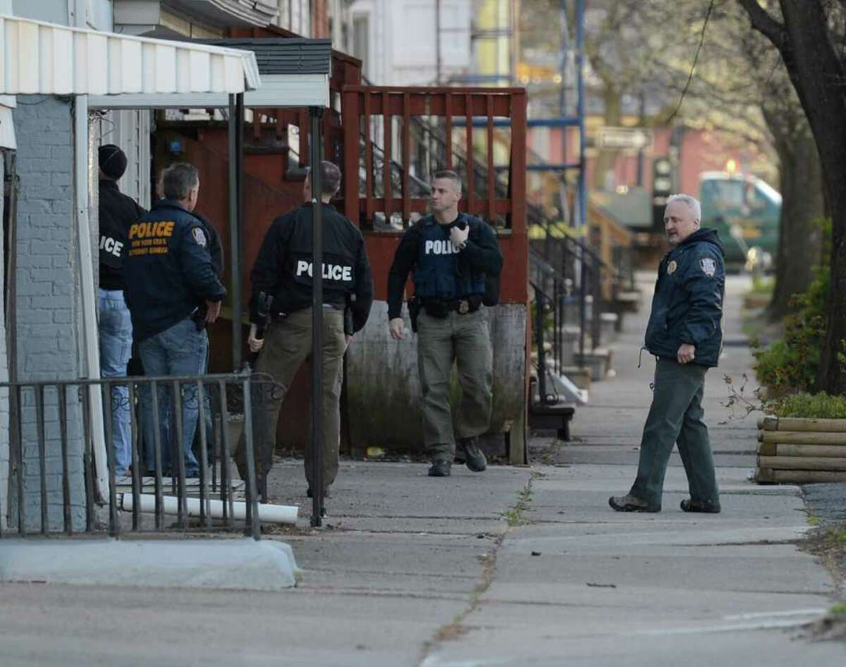 Members of the state attorney general's office investigative unit and members of the Albany Police Department check for suspected gang members Tuesday on lower Madison Avenue in Albany. (Skip Dickstein / Times Union)
