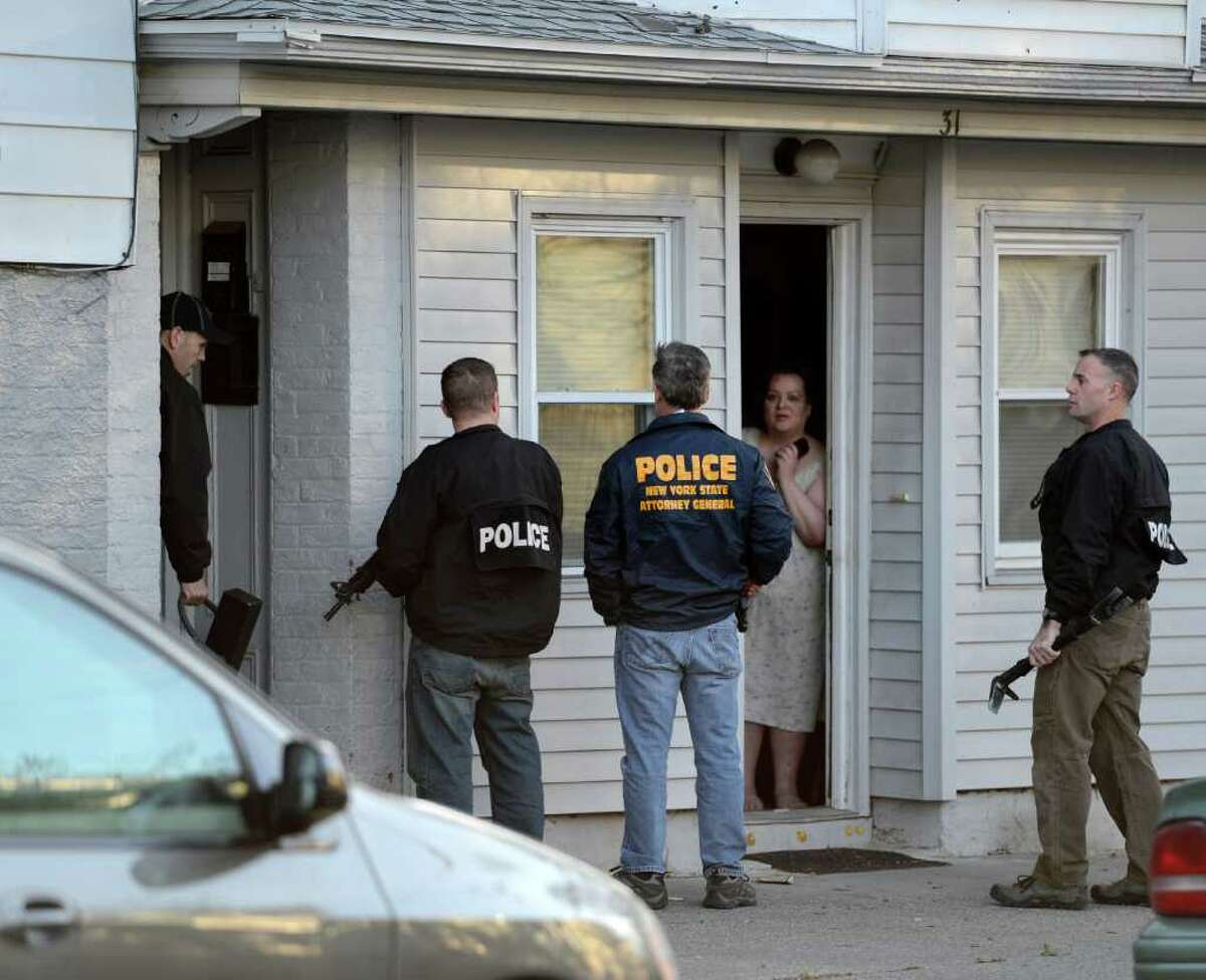 Members of the NYS Attorney Generals investigative unit along with members of the Albany Police Department check an address 31 Dana Avenue in Albany, N.Y. March 27, 2012. (Skip Dickstein / Times Union)