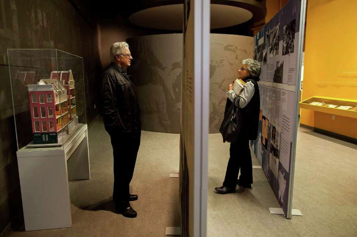 NEW YORK, NY - MARCH 26: Susan Hindin (R) and Howard Hindin of Long Island, New York views an exhibit at the Anne Frank Center USA on March 26, 2012 in New York City. The center, which opened on March 15, 2012, attempts to inspire tolerance by sharing about the life and thoughts of Anne Frank, a victim of the Holocaust.