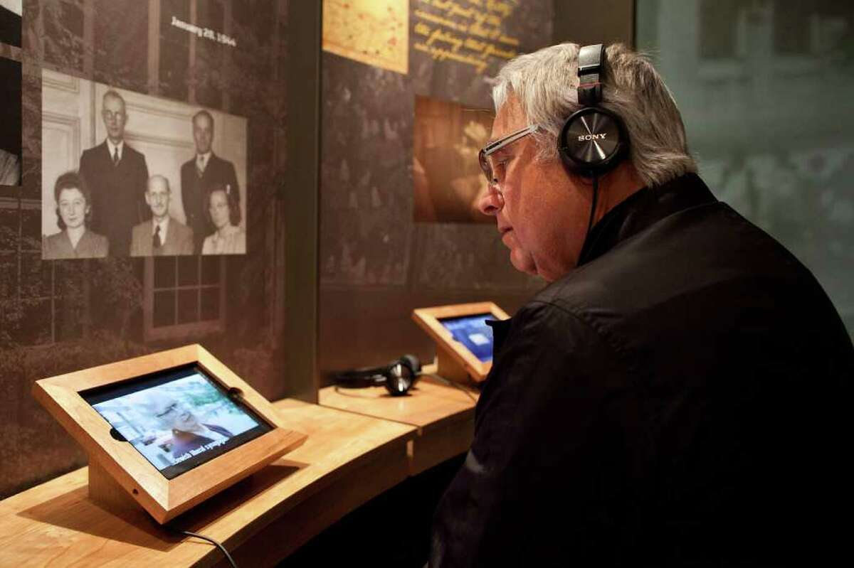 NEW YORK, NY - MARCH 26: Howard Hindin of Long Island, New York watches a video on an iPad at the Anne Frank Center USA on March 26, 2012 in New York City. The center, which opened on March 15, 2012, attempts to inspire tolerance by sharing about the life and thoughts of Anne Frank, a victim of the Holocaust.