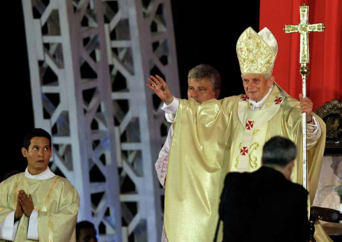 Pope Benedict XVI, top right, celebrates Mass at the Revolution Square in Santiago de Cuba, Cuba, Monday, March, 26, 2012.