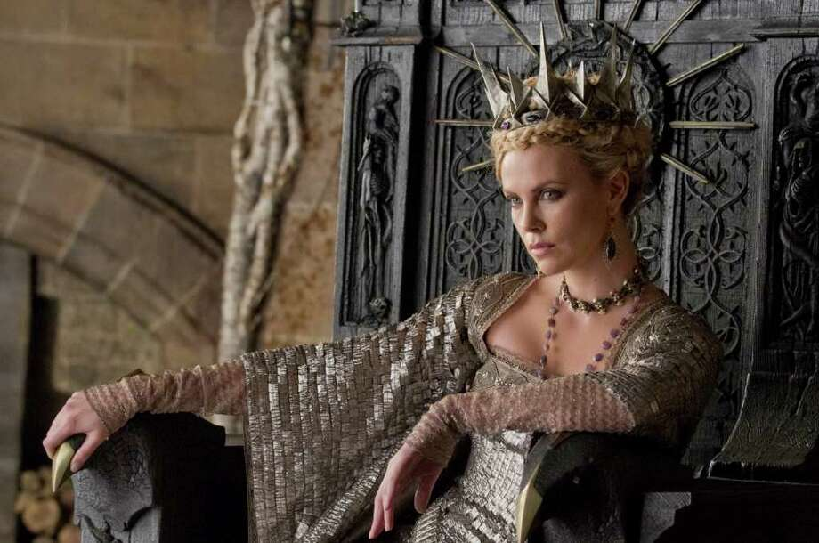 """Charlize Theron is the queen in the epic action-adventure film """"Snow White and the Huntsman,"""" a new vision of the tale. Photo: Photo Credit: Alex Bailey"""