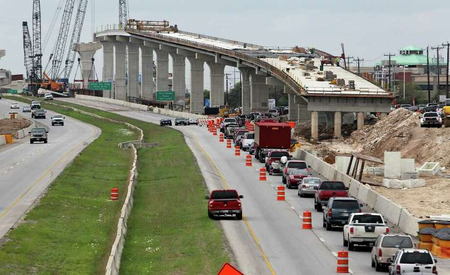 Area roadwork is necessary, but so are funds to pay for it. San Antonio and Bexar County are lagging in new, local sources of road revenue. Photo: Tom Reel, San Antonio Express-News / San Antonio Express-News