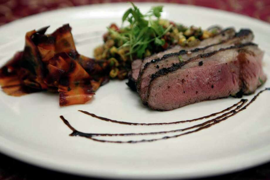TASTE:   Grilled Leg of Colorado Lamb with Pickled Corn Relish at Las Canarias for Chefs Secrets.  Photographed Tuesday March 27, 2012.  Helen L. Montoya/San Antonio Express-News Photo: HELEN L. MONTOYA, San Antonio Express-News / ©SAN ANTONIO EXPRESS-NEWS