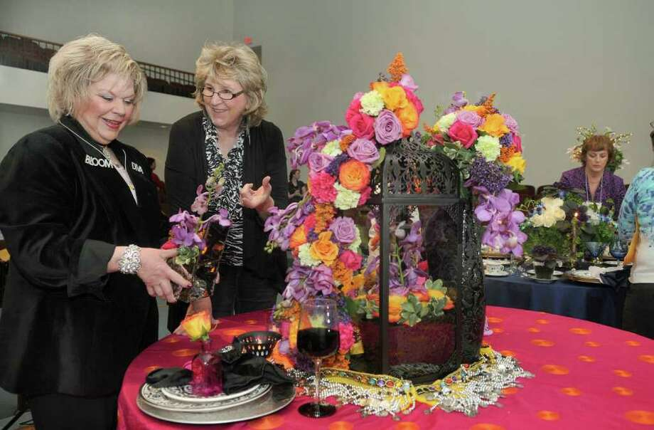Lana King, from left, of The Woodlands, and Pam Bates, of Houston, check out Bates' tabletop demo that was on display during the meeting of the Society for the Advancement of Floral Design at the Cypress Creek Community Center. Photo: Jerry Baker