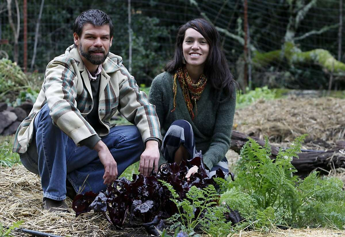 Matthew Hoffman and Astrid Lindo, co-founders of The Living Seed Company, work in their garden in Nicasio, Calif. on Monday, Feb. 20, 2012.