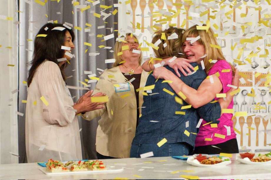 "In this photo provided by Pillsbury/General Mills, confetti flies as Christina Verrelli, right, celebrates with fellow finalists, from left,  Maria Vasseur, Donna Wolfe and Terri Sherman after being named the $1 million grand prize winner of the 45th Pillsbury Bake-OffÆ Contest, Tuesday, March 27, 2012 in Orlando, Fla.   The recipe for  Pumpkin Ravioli with Salted Caramel Whipped Cream was selected from tens of thousands of entries.  The announcement came during a special live broadcast of Hallmark Channel's ""The Martha Stewart Show,"" at the Peabody Orlando Hotel in Florida.  (AP Photo/Pillsbury/General Mills, Todd Rosenberg ) Photo: Todd Rosenberg, Associated Press / Todd Rosenberg Photography"