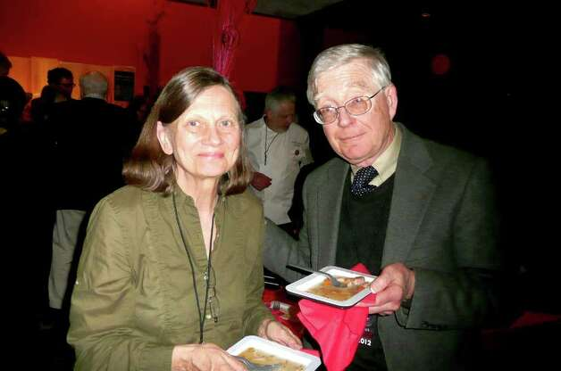 Lisette and Robert Henry, of Greenwich, sample some of the fine French cuisine at the Focus on French Cinema gala buffet. Robert, born in Normandy, is a native of France. Photo: Anne W. Semmes