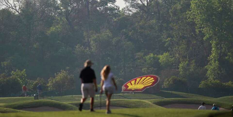 Golf fans enjoy a cool morning to watch Shell Houston Open golfers practice, Tuesday, March 27, 2012