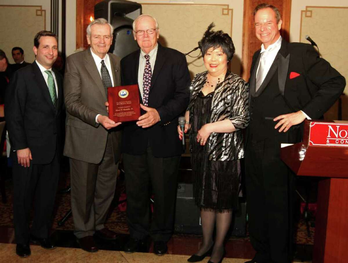 Bill and Jim Gardella receive the Beacon Award for the family of Louis J. Gardella Sr. last Saturday at the Lightkeeper's Gala at the Norwalk Inn. From l to r: State Sen. Bob Duff (D-Norwalk); Bill Gardella, Sr.; James Gardella, Irene Dixon, president of the Norwalk Seaport Association and David Smith.