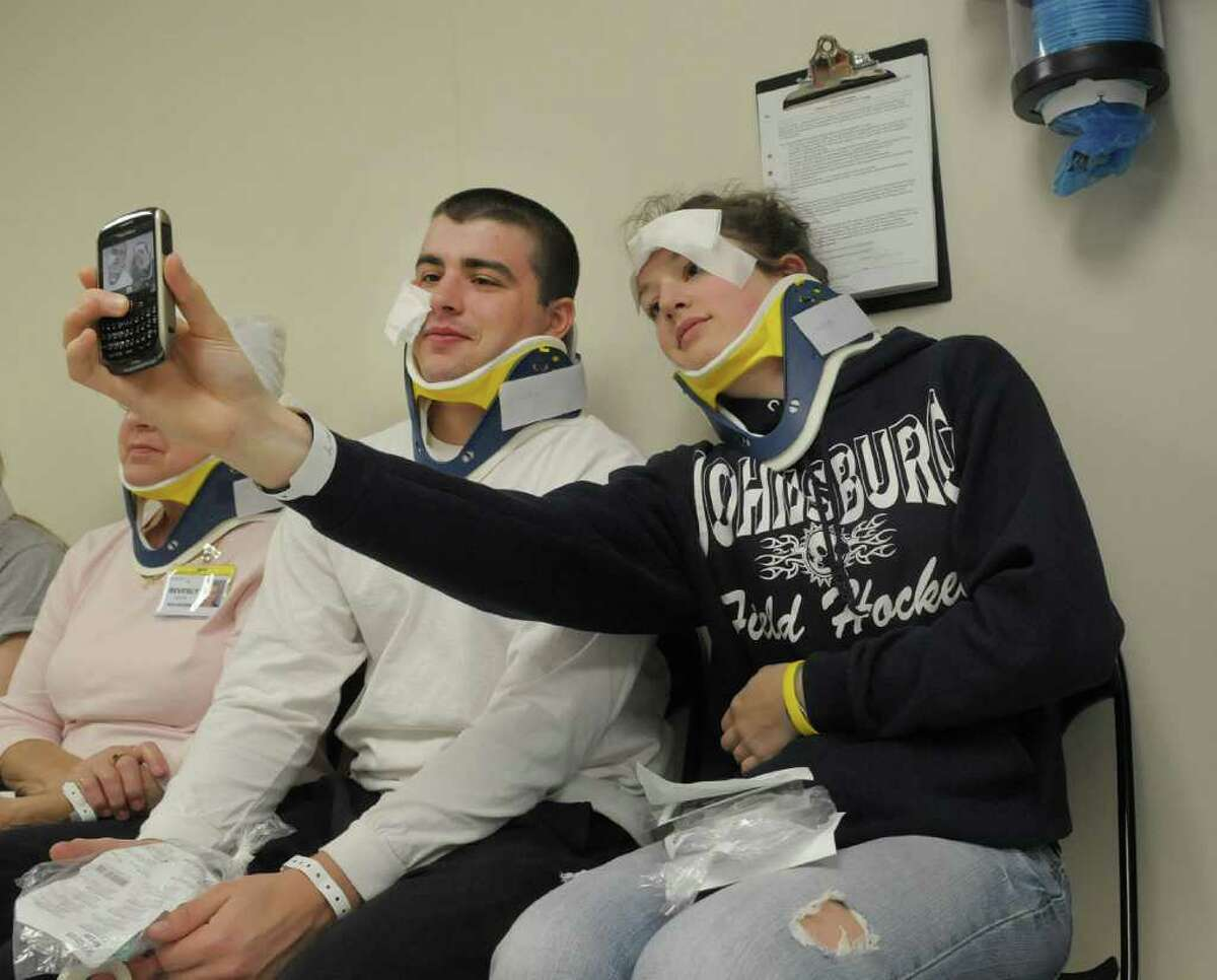James Rizzo, left, a student at Glens Falls High School, and Emily Liebelt, 17, a student at Johnsburg Central Schools, take of a photograph of themselves as the play the part of injured patients during a emergency drill at Glens Falls Hospital on Tuesday morning, March 27, 2012 in Glens Falls, NY. Glens Falls Hospital and 18 other regional hospitals in New York state took part in the drill, which simulated patients coming in after a tornado struck the area. Area high school students played the part of injured patients. Students showed up hours before the event to be made up so the injuries looked more real. (Paul Buckowski / Times Union)