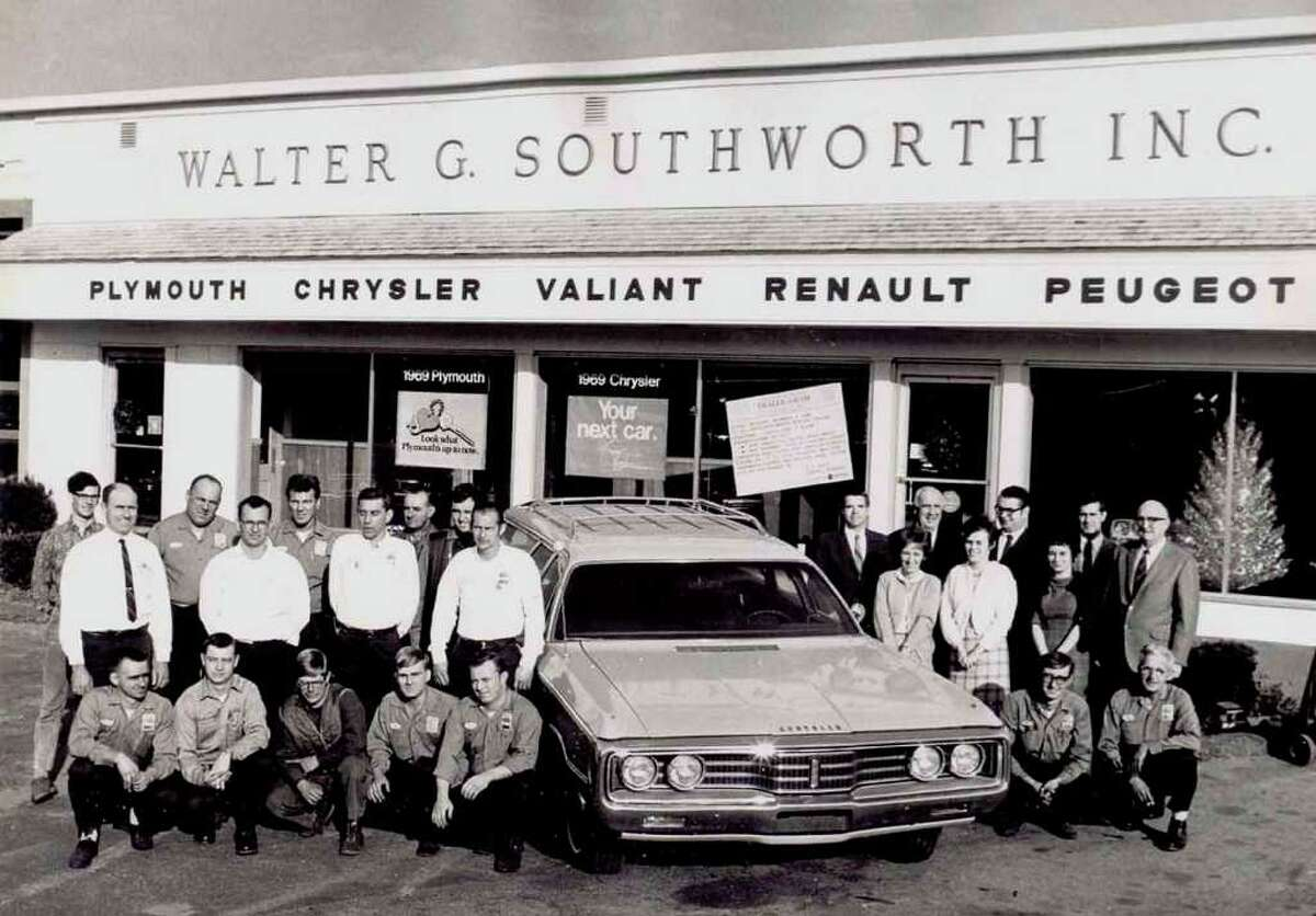 Courtesy of Southworth's A variety of makes and models of cars were available to purchase at Walter G. Southworth Inc. in New Milford in 1969, as evident on the front of the building. On staff at that time were, from left to right, in front, Austin Barney, Bill Hipp, Dan Vuille, Dave Carnicke, Ron Williams Sr., Martin Titus and Ray Pedersen; second row, Jim Williams Sr., George Beatty, Henry Burch, Ed Berry, Olive ìBabeî Williams, Geri Hipp and Ruth (last name unknown); and in back, Rick Oviatt, Art Seaford, Phil Marese, Frank Shrack, Bob Kindilien, owner Walter Southworth, Henry ìHankî Becker, John McRoberts, Hugh Fitzpatrick and Joe Stiller. The staff of Walter G. Southworth's Inc. car dealership along Route 7 in New Milford, circa late 1960s or early '70s? Walter Southworth is closest to car to the right; service manager Jim Williams, father of current owner Jim Williams, is farthest left in middle row, to the left of the car.