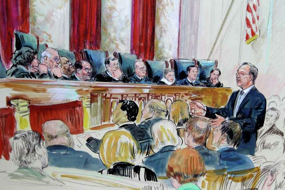 This artist's rendering shows attorney Paul Clement speaking in front of the Supreme Court as the court continued to hear arguments on the health care law. The justices are Sonia Sotomayor (from left), Stephen Breyer, Clarence Thomas, Antonin Scalia, Chief Justice John Roberts, Anthony Kennedy, Ruth Bader Ginsburg, Samuel Alito and Elena Kagan. Photo: Dana Verkouteren, Associated Press