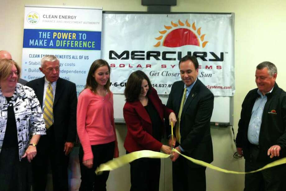 Town officials unveiled a new solar energy system at the Greenwich High School on Tuesday, March 27, 2012. Left to right, Greenwich Conservation Director Denise Savageau, Superintendent of Schools Roger Lulow, Greenwich High School Environmental Action Club President Siena Rumbough; Board of Education Chairman Leslie Moriarty; First Selectman Peter Tesei; and Mercury Solar Systems CEO Frank Alfano, take part in a ribbon-cutting ceremony. Photo: Lisa Chamoff
