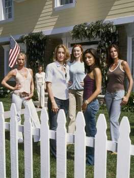 "A primetime soap with a truly contemporary take on ""happily every after,"" this new hour- long drama takes a darkly comedic look at suburbia, where the secret lives of housewives aren't always what they seem. ""Desperate Housewives"" stars (from left) Nicollette Sheridan as Edie Britt, Felicity Huffman as Lynette Scavo, Marcia Cross as Bree Van De Kamp, Eva Longoria as Gabrielle Solis, Teri Hatcher as Susan Mayer and Brenda Strong (background) as Mary Alice Young. (ABC)"