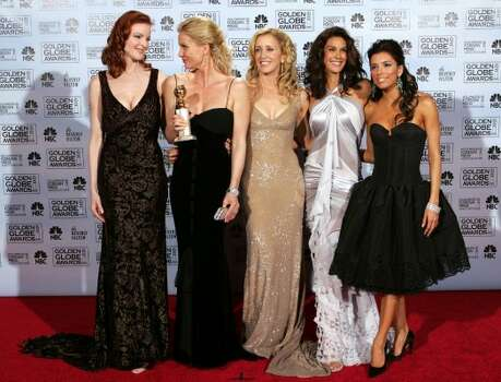 "The cast of ""Desperate Housewives,"" from left to right, Marcia Cross, Nicolette Sheridan, Felicity Huffman, Teri Hatcher, and Eva Longoria pose backstage after accepting the award for best television series musical or comedy at the 62nd Annual Golden Globe Awards on Sunday, Jan. 16, 2005, in Beverly Hills, Calif. (AP Photo/Reed Saxon) (AP)"