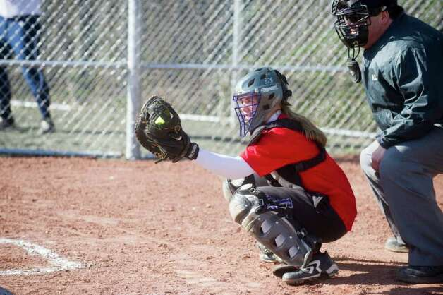 Westhill's Elizabeth Joseph behind the plate as Westhill High School hosts Staples in a softball game in Stamford, Conn., March 27, 2012. Photo: Keelin Daly / Stamford Advocate