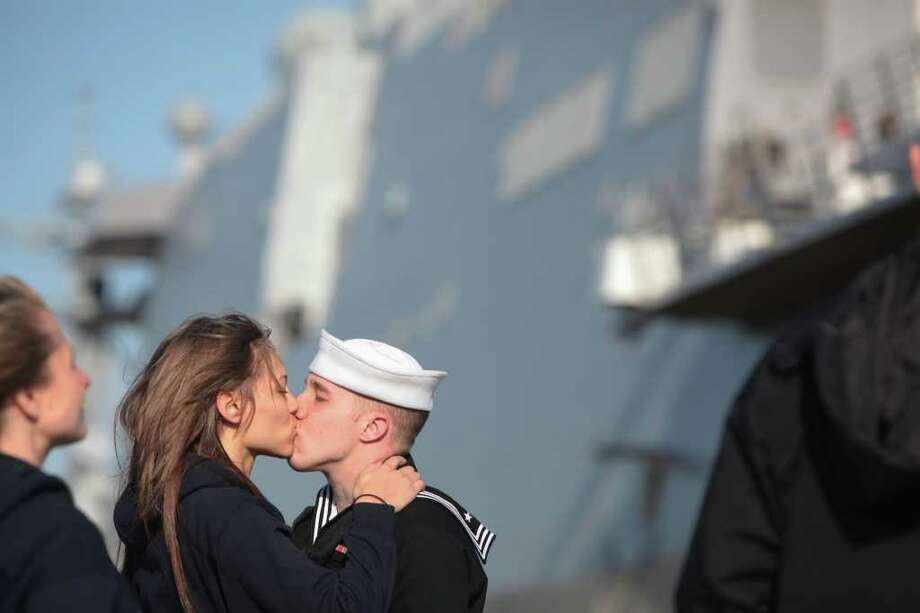 Marissa Shadler kisses boyfriend Cory Dutkiewicz goodby as he prepares to deploy on The USS New York, an amphibious transport dock ship, from Naval Station Norfolk in Norfolk, Va. on Tuesday, March 27, 2012. This is the first deployment of the ship, parts of which were built with steel from the World Trade Center. Photo: Steve Earley, Associated Press / The Virginian-Pilot
