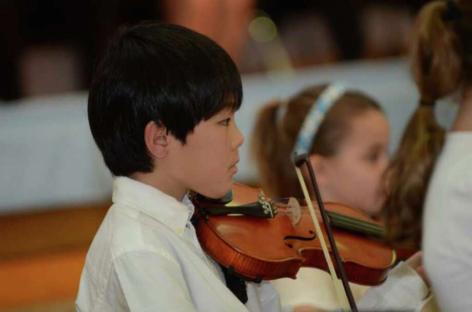 Old Greenwich Elementary School band student Yoshitaro Awazu plays the violin during the Greenwich Public Schools annual Community Service Awards at the Old Greenwich School auditorium on Tuesday, Mar. 27, 2012. Photo: Amy Mortensen / Connecticut Post Freelance