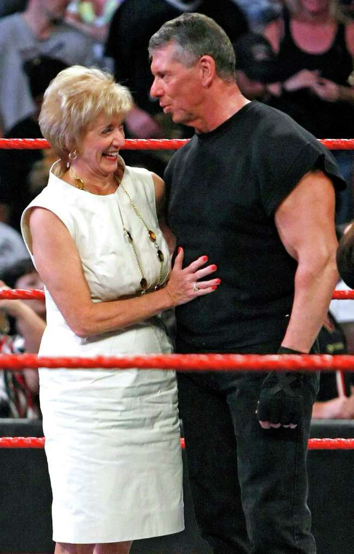 Former World Wrestling Entertainment Inc. CEO Linda McMahon and her husband, Vince McMahon, appear in the ring during Vince McMahon's 64th birthday celebration at the WWE Monday Night Raw show in Las Vegas, Nev. in 2009.