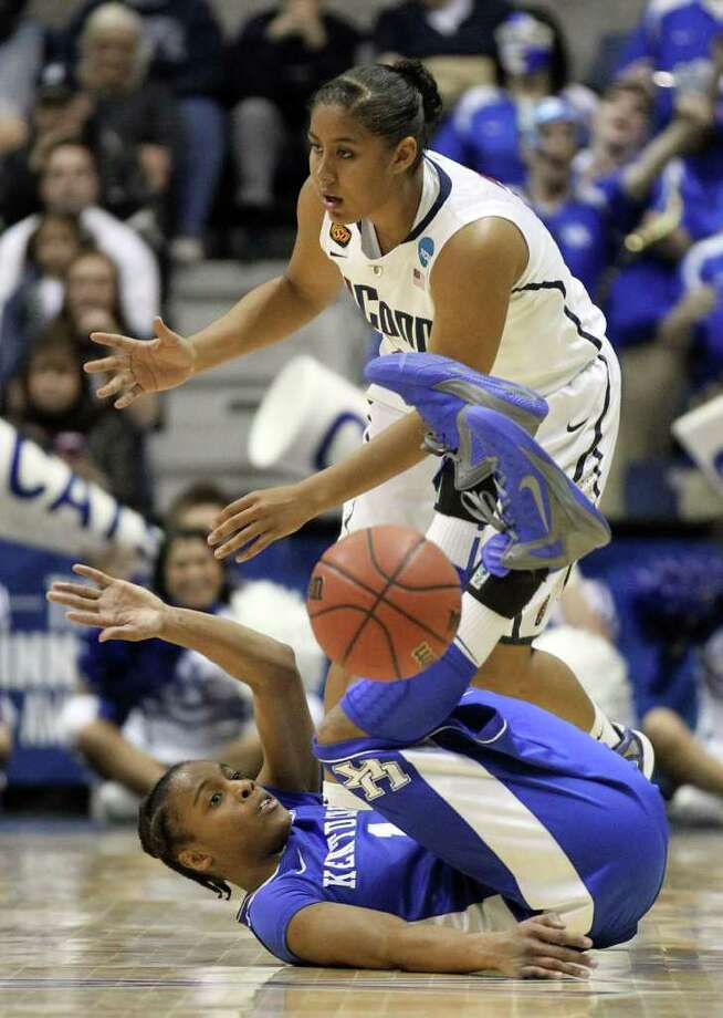 Connecticut forward Kaleena Mosqueda-Lewis, top, fouls Kentucky guard A'dia Mathies (1) during the first half of an NCAA women's college basketball tournament regional final in Kingston, R.I., Tuesday, March 27, 2012. (AP Photo/Stew Milne) Photo: Stew Milne/Associated Press / FR56276 AP