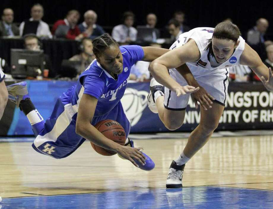 Kentucky guard A'dia Mathies (1) and Connecticut guard Kelly Faris, right, battle for possession of the ball during the first half of an NCAA women's college basketball tournament regional final in Kingston, R.I., Tuesday, March 27, 2012. (AP Photo/Stew Milne) Photo: Stew Milne/Associated Press / FR56276 AP