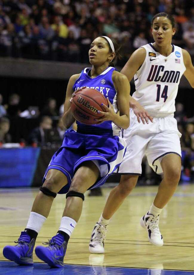 Kentucky guard Keyla Snowden puts on the brakes to take a jumper as Connecticut guard Bria Hartley (14) watches during the first half of the NCAA women's college basketball tournament East Regional final in Kingston, R.I., Tuesday, March 27, 2012. (AP Photo/Stew Milne) Photo: Stew Milne/Associated Press / AP