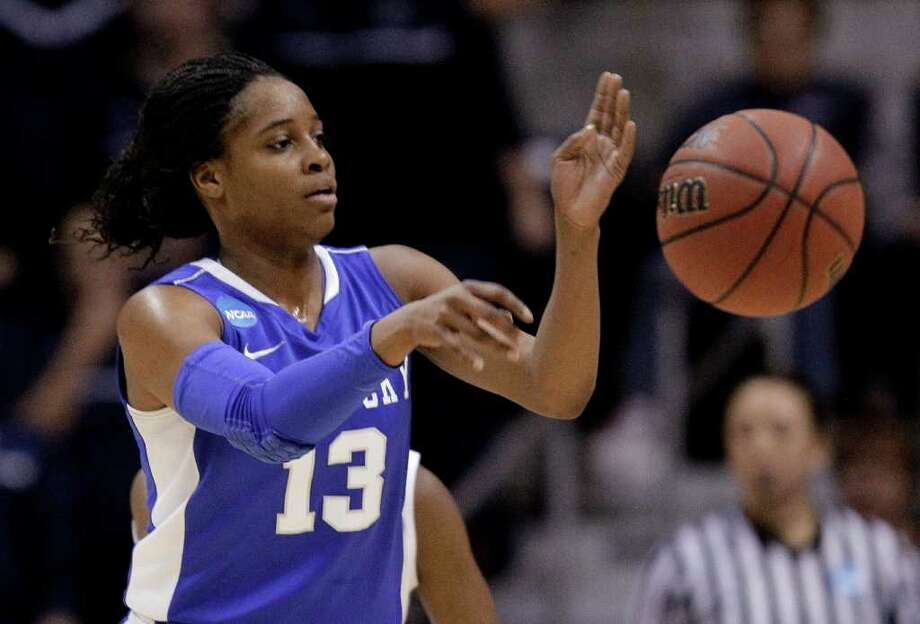 Kentucky guard Bria Goss passes the ball during the first half of the NCAA women's college basketball tournament East Regional final against Connecticut in Kingston, R.I., Tuesday, March 27, 2012. (AP Photo/Stephan Savoia) Photo: Stephan Savoia, Associated Press / AP