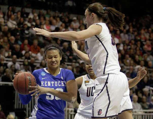 Kentucky center Azia Bishop (50) pulls in a rebound as Connecticut guard Kelly Faris (34) jumps during the first half of the NCAA women's college basketball tournament East Regional final in Kingston, R.I., Tuesday, March 27, 2012. (AP Photo/Stephan Savoia) Photo: Stephan Savoia, Associated Press / AP