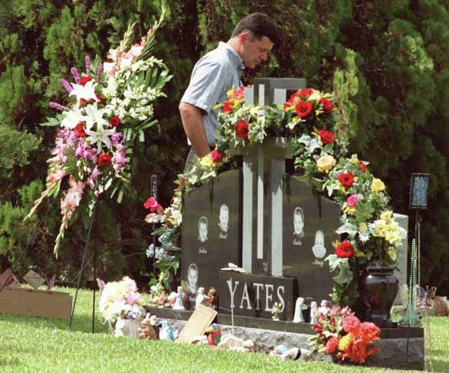 Russell Yates walks past the grave of his murdered children Thursday morning June 20, 2002, the one year anniversary of the children's death at the hands of their mother, Andrea Yates. Photo: Karl Stolleis, Houston Chronicle / Houston Chronicle