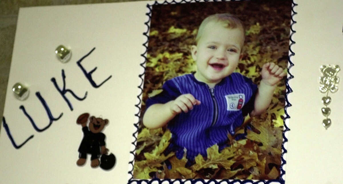 Luke Yates, 2, is shown in this undated family snapshot mounted to a poster that sat outside Clear Lake Church of Christ during his funeral service Wednesday, June 27, 2001 in Houston.