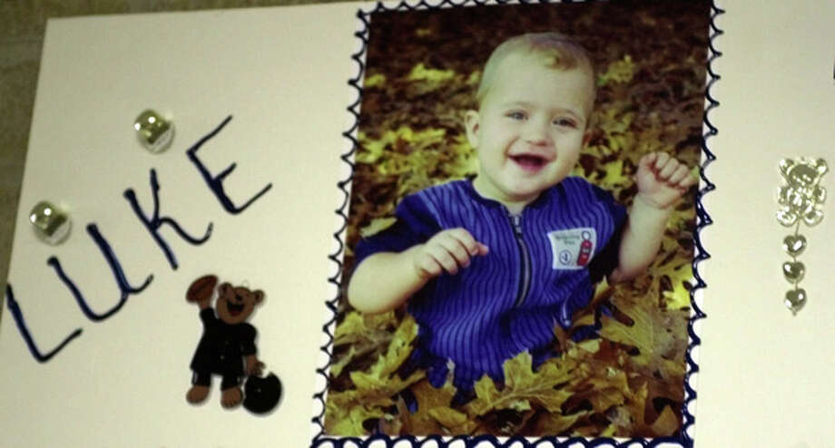 Luke Yates is shown in this undated family snapshot mounted to a poster that sat outside Clear Lake Church of Christ during his funeral service Wednesday, June 27, 2001 in Houston. Luke, 2, and his four siblings were allegedly killed by their mother, Andrea Yates. Photo: Houston Chronicle / YATES FAMILY