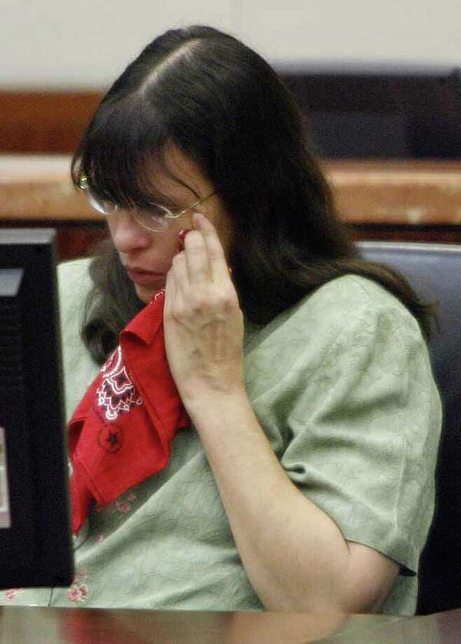 Andrea Yates weeps during closing arguments in her retrial July 24, 2006 in Houston, Texas. Yates' 2002 capital murder conviction for drowning her five children in a bath tub was overturned by an appeals court because of false testimony by the state's expert psychiatric witness.  (Photo by Brett Coomer-Pool/Getty Images) *** Local Caption *** Andrea Yates Photo: Pool, Houston Chronicle / Getty Images North America