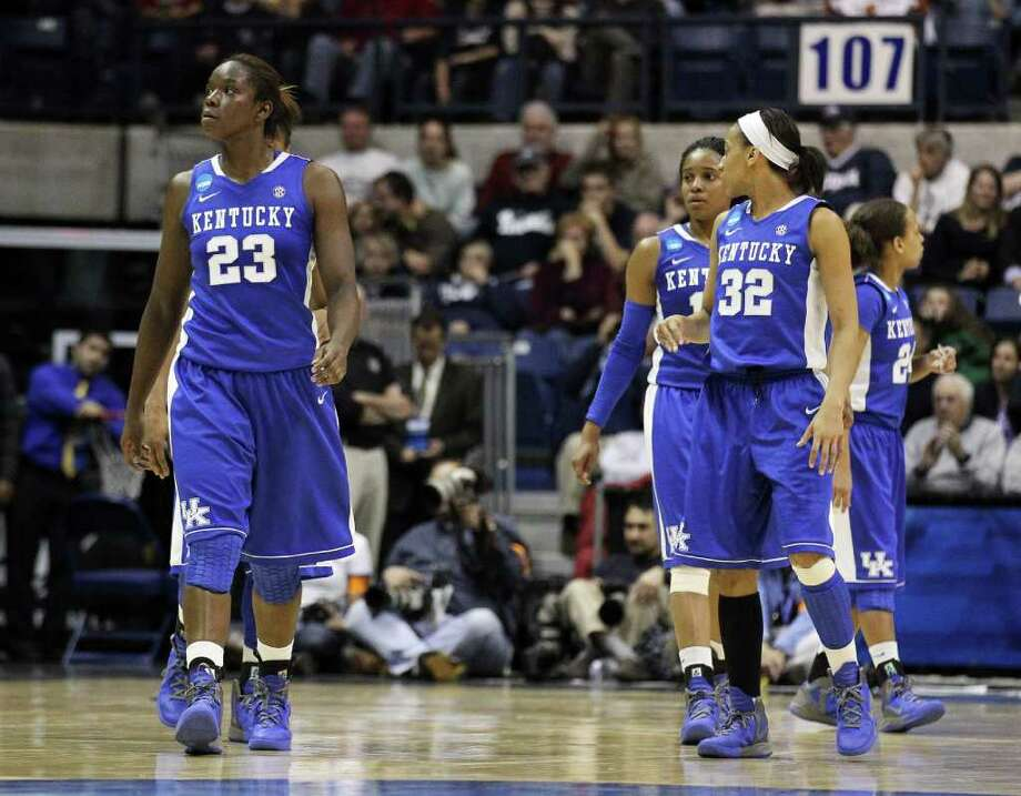 Kentucky forward Samarie Walker (23) and guard Kastine Evans (32) walk back onto the court after a timeout during the second half of an NCAA women's college basketball tournament regional final against Connecticut in Kingston, R.I., Tuesday, March 27, 2012. Connecticut won 80-65.(AP Photo/Stew Milne) Photo: Stew Milne, Associated Press / FR56276 AP