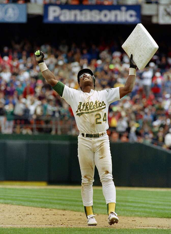 ** FILE ** In this May 1, 1991, file photo, Oakland Athletics' Rickey Henderson celebrates and raises third base after setting the all-time stolen base record during the Athletics' baseball game in Oakland, Calif., against the New York Yankees. The stolen base was Henderson's 939th, moving him past Lou Brock. Henderson was voted into baseball's Hall of Fame on Monday, Jan. 12, 2009. (AP Photo/Eric Risberg, File) Photo: Eric Risberg, AP Photo