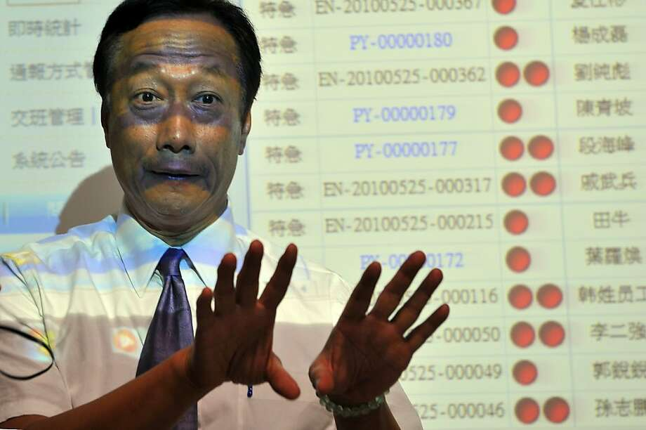 Terry Gou, chairman of Foxconn's Taiwanese parent company Hon Hai Precision gives a press conference at the giant Foxconn plant in Shenzen on May 26, 2010. The Taiwanese boss of Apple manufacturer Foxconn headed to a sprawling factory in southern China where a spate of worker suicides have stoked anger about labour conditions. Terry Gou, the chairman of Foxconn's parent company Hon Hai Precision, flew into the booming city of Shenzhen aboard his private jet with travelling Taiwanese reporters, urging themedia to see the factory for themselves. Photo: Voishmel, AFP/Getty Images