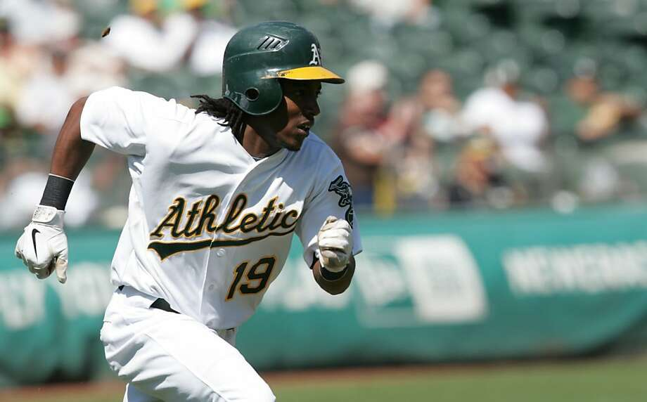 The Athletics' Jemile Weeks runs after a hit during the first inning at the coliseum in Oakland, Calif., on Thursday, Sept. 22, 2011. Photo: Mathew Sumner, Special To The Chronicle