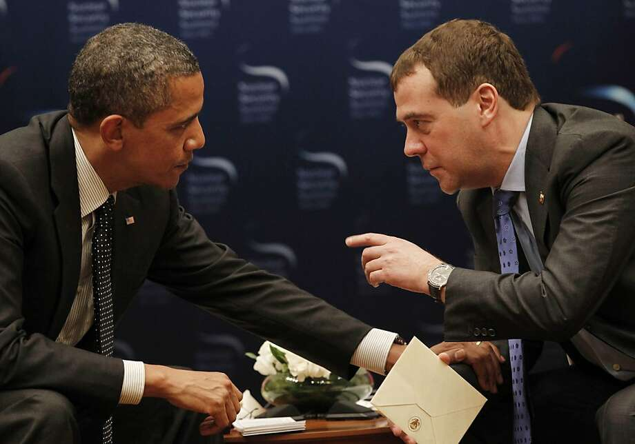 U.S. President Barack Obama, left,  chats with Russian President Dmitry Medvedev during a bilateral meeting at the Nuclear Security Summit in Seoul, South Korea, Monday, March, 26, 2012. (AP Photo/Pablo Martinez Monsivais) Photo: Pablo Martinez Monsivais, Associated Press